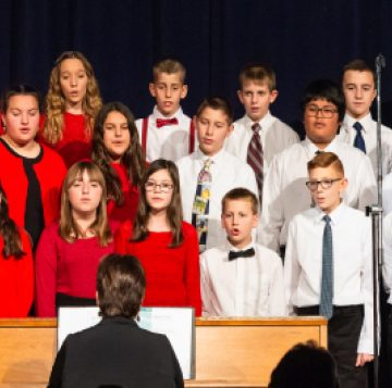 Choir students performing for middle school art