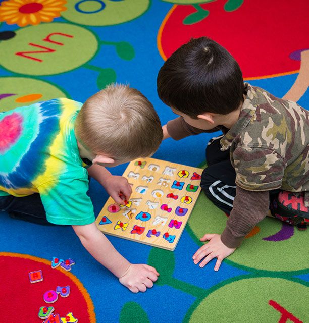 private christian preschool students are playing