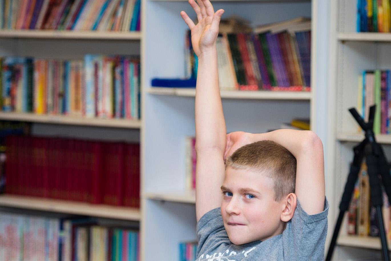 student raises hand in private middle school Harrisonburg, VA
