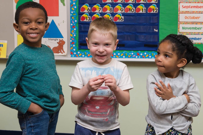 preschoolers smiling in the Cornerstone Christian Preschool in Harrisonburg, VA