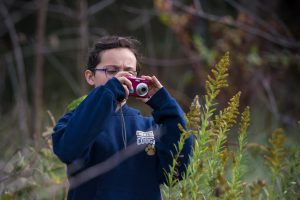 A student at Christian Middle School in Virginia learns photography