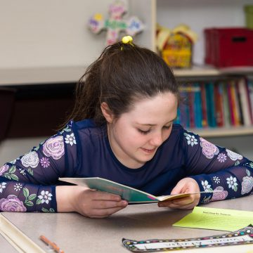 a student reading books in private christian elementary schools near me