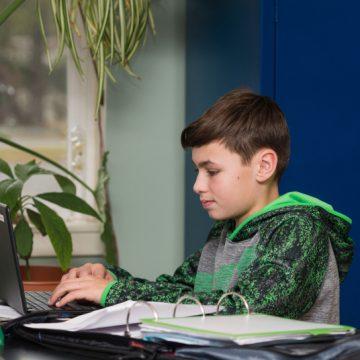 a student sitting in faith christian elementary school in VA
