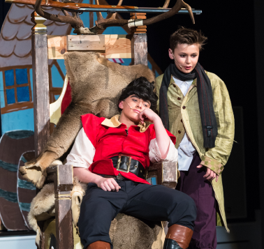 two students playing acting roles in theater for middle school art
