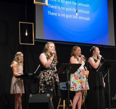 students singing worship songs for middle school art lessons